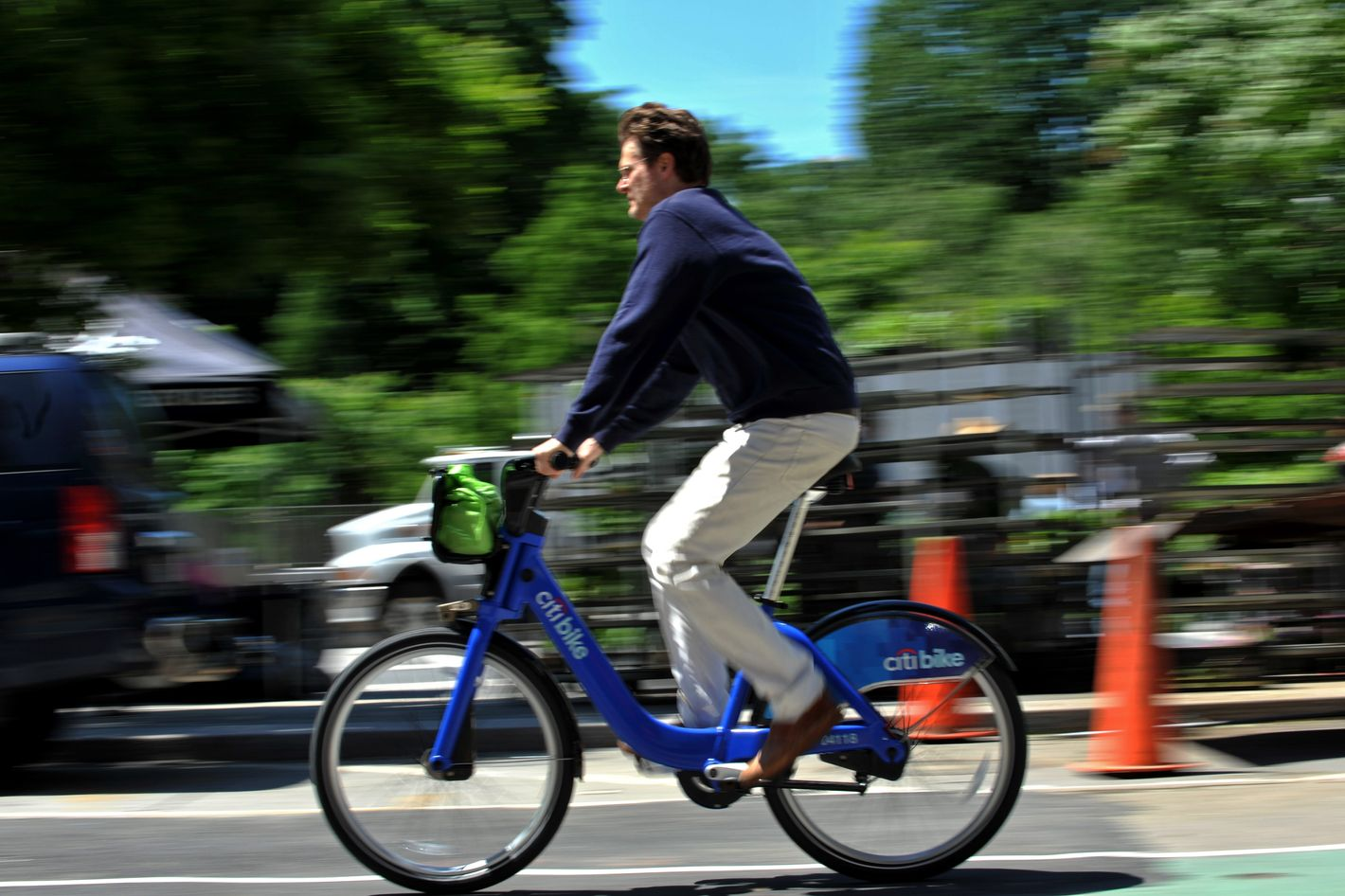 A man rides a Citi Bike bicycle near Union Square as the bike sharing system is launched May 27, 2013 in New York. About 330 stations in Manhattan and Brooklyn will have thousands of bicycles for rent.