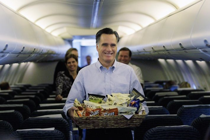 JACKSONVILLE, FL - JANUARY 30:  Republican presidential candidate and former Massachusetts Gov. Mitt Romney carries snacks to reporters on his plane at the Jacksonville International airport before flying to St. Petersburg, Florida on January 30, 2012 in Jacksonville, Florida. Romney is campaigning across the state ahead of the January 31 Florida primary.  (Photo by Joe Raedle/Getty Images)