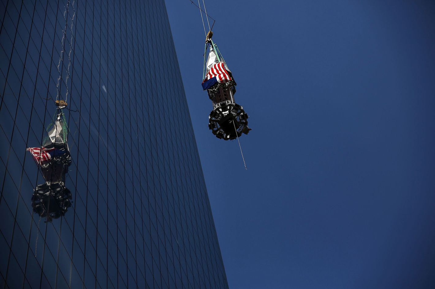The 408-foot spire is hoisted onto a temporary platform on the top of One World Trade Center on May 2, 2013 in New York City. When bolted into place at a later date, the spire will make One World Trade Center the tallest building in the Western Hemisphere.The raising of the spire, which comes on the second anniversary of the death of Osama bin Laden, will make One World Trade Center 1,776 feet tall. One World Trade Center is built on the site where the September 11, 2001 attacks toppled the original World Trade Center towers.