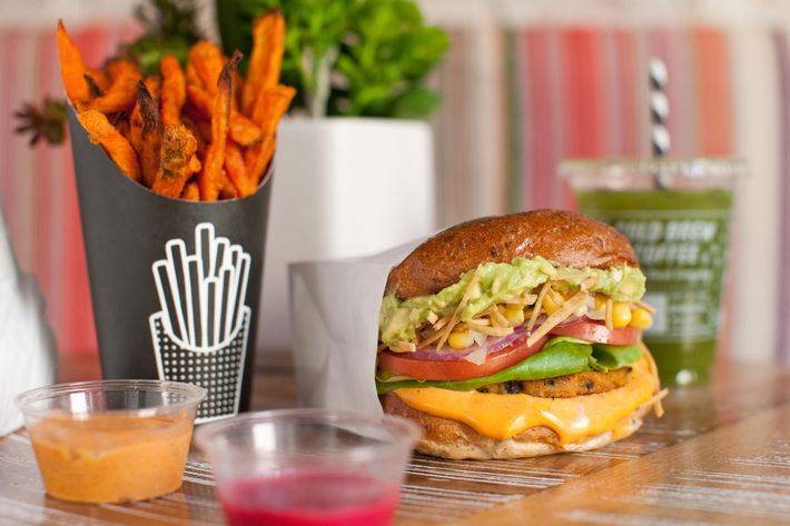 "The hearty Guac Burger, with ""air-baked"" sweet-potato fries. Everything on the menu is vegan."