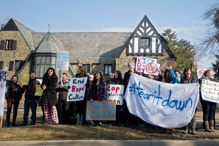 Protestors outside Penn State's Kappa Delta Rho fraternity house.