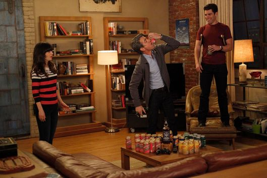 "The gang plays drinking games when Jess (Zooey Deschanel, L) invites Russell (guest star Dermot Mulroney, C) to spend the weekend at the loft in the""Normal"" episode of NEW GIRL."