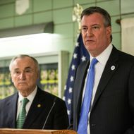 New York City Mayor Bill DeBlasio (R) and New York Police Department Commissioner Bill Bratton speak at a press conference at the NYPD's 25th Precinct on February 27, 2014 in New York City. Mayor Bill DeBlasio and Commissioner Bratton spoke to the officers and held a press conference after an officer was shot in the leg in the Crown Heights neighborhood of Brooklyn, yesterday.