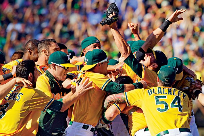 Oakland Athletics relief pitcher Grant Balfour, third right looking, up celebrates with teammates after their 12-5 win over the Texas Rangers in a baseball game, Wednesday, Oct. 3, 2012 in Oakland, Calif. The A's clinch the AL West title with the win. (AP Photo/Ben Margot)