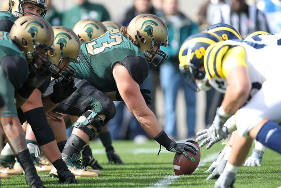 EAST LANSING, MI - OCTOBER 15:  Travis Jackson #62 of the Michigan State Spartans gets ready to snap the ball during the game against the Michigan Wolverines at Spartan Stadium on October 15, 2011 in East Lansing, Michigan.  Michigan State defeated Micigan 28-14.  (Photo by Leon Halip/Getty Images)