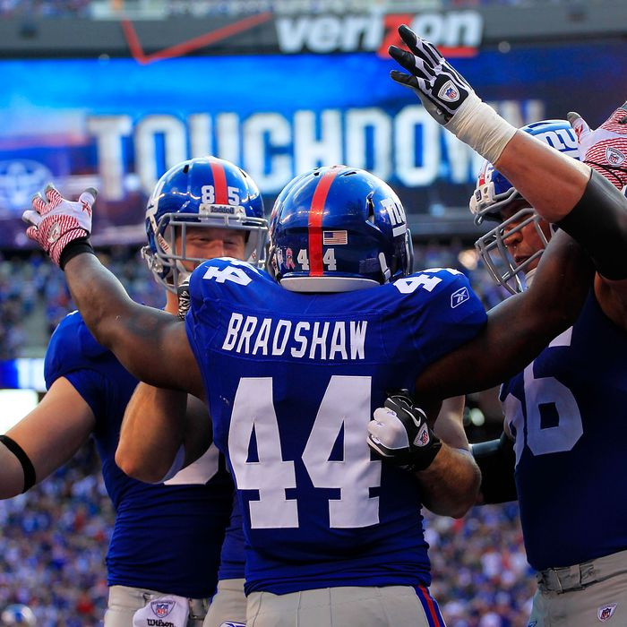 EAST RUTHERFORD, NJ - OCTOBER 16: Ahmad Bradshaw #44 of the New York Giants celebrates a one yard touchdown with his teammates in the third quarter against the Buffalo Bills at MetLife Stadium on October 16, 2011 in East Rutherford, New Jersey. (Photo by Chris Trotman/Getty Images)