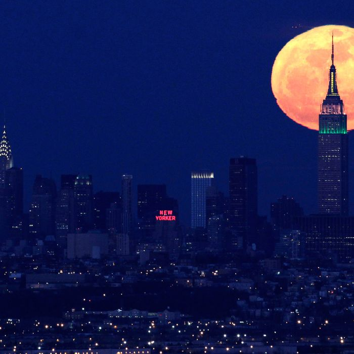 A full moon rises behind the Empire State Building in New York in this view from Eagle Rock Reservation in West Orange, N.J., in this April 6, 2012 file photo. The biggest and brightest full moon of the year arrives Saturday night May 5, 2012 as our celestial neighbor passes closer to Earth than usual. Saturday's event is a