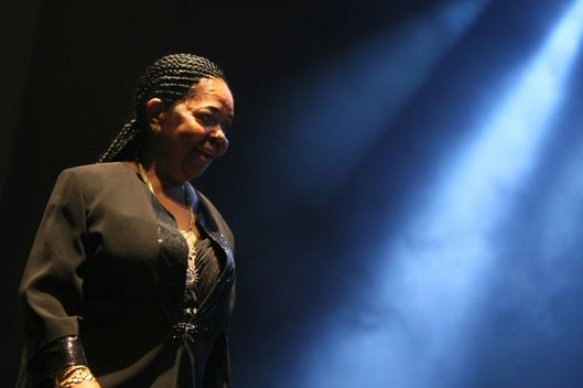 "(FILES) - A file picture taken on October 10, 2009 in Paris shows Legendary Cape Verdean singer Cesaria Evora, nicknamed the ""barefoot diva,"" performing during a concert. Evora died on December 17, 2011 in a hospital in Cape Verde, Cape Verde Culture Minister said. Aged 70, the internationally famous singer, died nearly three months after she decided to retire due to ill health.