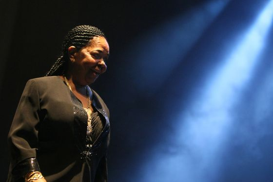 (FILES) - A file picture taken on October 10, 2009 in Paris shows Legendary Cape Verdean singer Cesaria Evora, nicknamed the barefoot diva, performing during a concert. Evora died on December 17, 2011 in a hospital in Cape Verde, Cape Verde Culture Minister said. Aged 70, the internationally famous singer, died nearly three months after she decided to retire due to ill health.