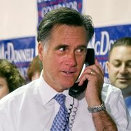 Republican presidential candidate former Governor Mitt Romney (C), R-MA makes a phone call as he greets and thanks Fairfax County Republican Committee phone bank volunteers at their headquarters in Fairfax, Virginia, October 26, 2011.                             AFP PHOTO/Jim WATSON (Photo credit should read JIM WATSON/AFP/Getty Images)