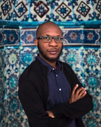 HEBRON - WEST BANK - JUNE 3: Nigerian-American writer Teju Cole poses for a portrait inside the Ibrahimi mosque or Tomb of the Patriarchs during a 2014 Palestine Festival of Literature tour on June 3, 2014 in Hebron, West Bank. The festival is an annual event that aims to bring a cultural festival of international standard to audiences in Palestine to assert