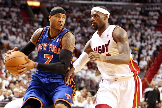 Forward LeBron James #6 of the Miami Heat defends Forward Carmelo Anthony#7 of the New York Knicks in Game Five of the Eastern Conference Quarterfinals in the 2012 NBA Playoffs  on May 9, 2012 at the American Airines Arena in Miami, Florida.