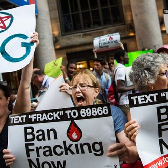 NEW YORK, NY - JUNE 30: Protesters demand a statewide ban on hydraulic fracturing, a controversial technique for removing oil and natural gas from the earth also known as 'fracking,' on June 30, 2014 in New York City. The protest was held outside a Democratic party event with New York Governor Andrew Cuomo attending. (Photo by Andrew Burton/Getty Images)