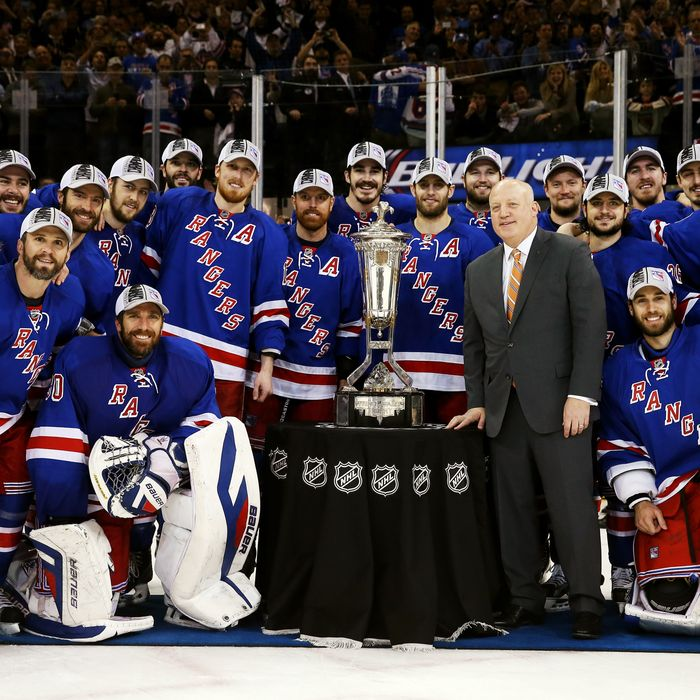 The New York Rangers pose with Deputy Commissioner Bill Daly and the Prince of Wales Trophy after defeating the Montreal Canadiens in Game Six to win the Eastern Conference Final in the 2014 NHL Stanley Cup Playoffs at Madison Square Garden on May 29, 2014 in New York City. The New York Rangers defeated the Montreal Canadiens 1 to 0.