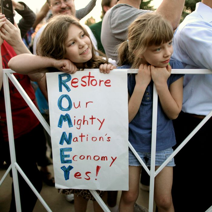 Members of an overflow crowd listen to Republican presidential candidate, former Massachusetts Gov. Mitt Romney