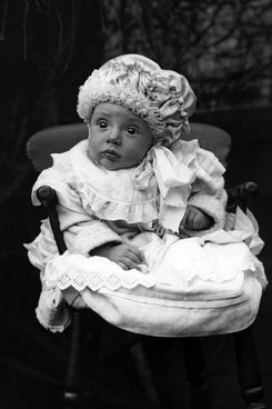 circa 1910:  A baby with wide, startled eyes sits in a chair.  (Photo by General Photographic Agency/Getty Images)