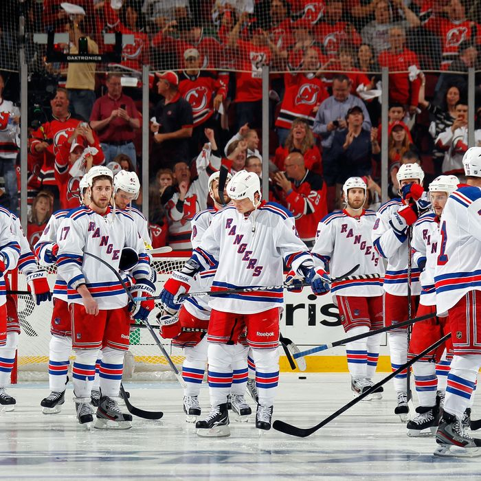 The New York Rangers look on after losing Game Six of the Eastern Conference Final during the 2012 NHL Stanley Cup Playoffs