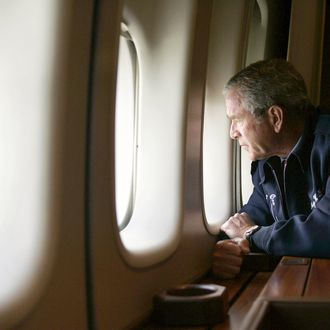 US President George W. Bush looks out the window of Air Force One 31 August, 2005, as he flies over New Orleans, Louisiana, surveying the damage left by Hurricane Katrina. Returning to Washington from Texas, Air Force One descended to about 5000 feet (1500 meters) to allow Bush to view some of the worst damage from Hurricane Katrina, which ravaged the Gulf Coast states of Louisiana, Alabama and Mississippi on 29 August.