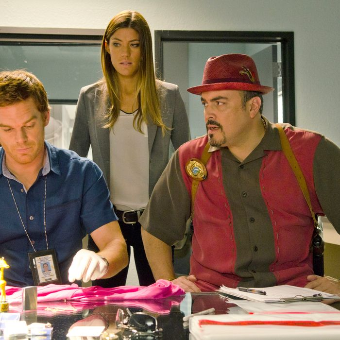 Jennifer Carpenter as Debra Morgan, Michael C. Hall as Dexter Morgan and David Zayas as Angel Batista (Season 7, episode 3)