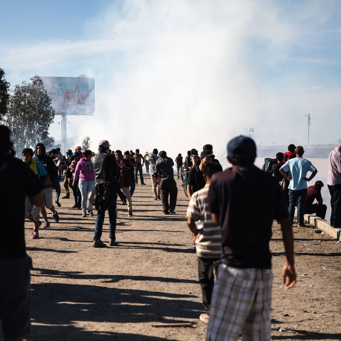 Migrants face tear gas from U.S. Border Patrol agents at San Ysidro.