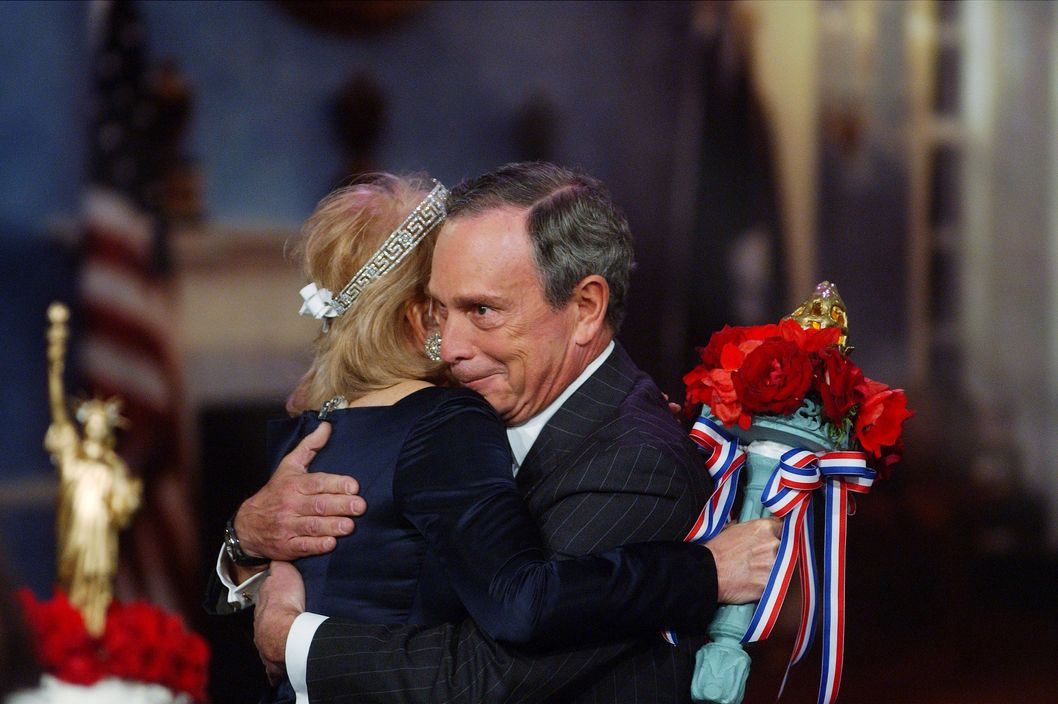 "Mayor Michael Bloomberg looks delighted as he hugs his ""bride,"" Barbara Walters, during a Fantasy Wedding segment of the television program ""The View."" Walters' original plan was to do the wedding with a cardboard cutout of the mayor, but he agreed to be on the show. Unfortunately, Bloomberg had to leave before having any of the wedding cake."