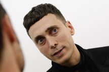 BERLIN - JUNE 30:  Artist and fashion designer Hedi Slimane talks to the media, during a group show curated by him at gallery Arndt & Partner on June 30, 2007 in Berlin, Germany.  (Photo by Miguel Villagran/Getty Images) *** Local Caption *** Hedi Slimane