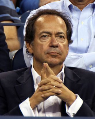John Paulson, president and co-fund manager of Paulson & Co. Inc., attends a tennis match during U.S. Open at the Billie Jean King National Tennis Center in New York, U.S., on Tuesday, Aug. 30, 2011. Paulson and his wife, Jenny, had planned to host a fund-raiser for Republican presidential hopeful Mitt Romney at their estate in Southampton on Sunday but it was postponed due to Hurricane Irene, according to Wall Street Journal. Photographer: Rick Maiman/Bloomberg via Getty Images