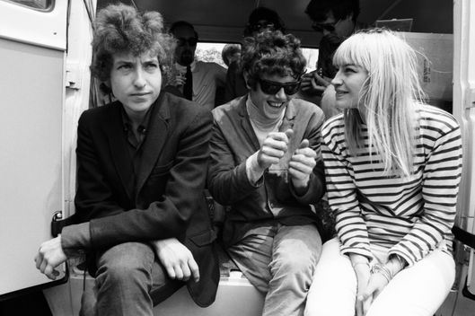 Musicians (L-R) Bob Dylan, Donovan, and Mary Travers of Peter Paul and Mary backstage at the Newport Folk Festival in July 1965 in Newport, Rhode Island.