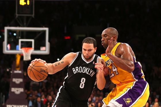 Deron Williams #8 of the Brooklyn Nets drives against Kobe Bryant #24 of the Los Angeles Lakers at Staples Center on November 20, 2012 in Los Angeles, California. The Lakers won 95-50.