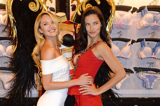 LONDON, ENGLAND - APRIL 15:  Victoria's Secret Angels Candice Swanepoel (L) and Adriana Lima pose at the New Bond Street store on April 15, 2014 in London, England, to announce that the Victoria's Secret Fashion Show, the biggest global fashion event in the world, is coming to London for the first time this winter. The show will be filmed for broadcast on the  CBS Television Network and shown in 192 countries.  (Photo by David M. Benett/Getty Images for Victoria's Secret) *** Local Caption *** Candice Swanepoel; Adriana Lima