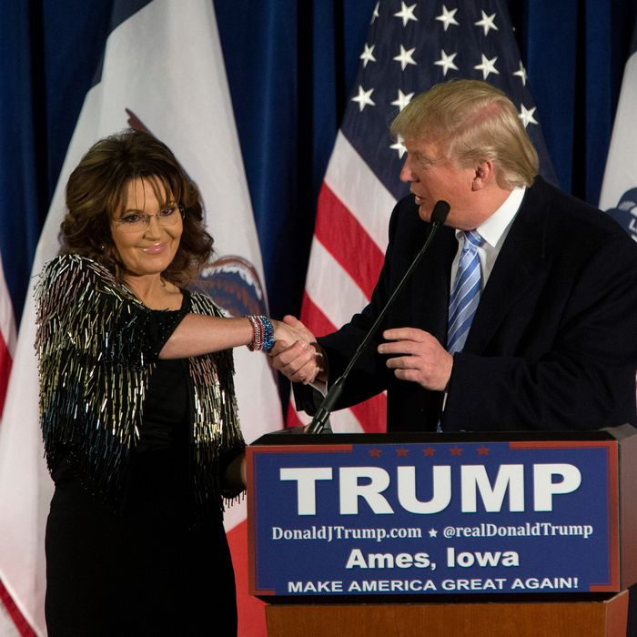 Donald Trump shakes hands with Sarah Palin on January 19, 2016 in Ames, IA. Trump received Palin's endorsement at the event.