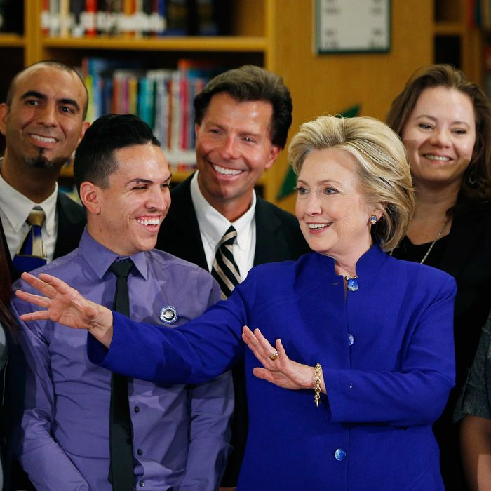 Democratic presidential candidate Hillary Rodham Clinton, center, speaks while posing for photos at an event at Rancho High School Tuesday, May 5, 2015, in Las Vegas.