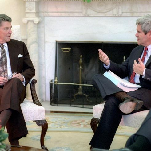 5/20/1985 President Reagan and Newt Gingrich in the Oval Office during a Meeting with the