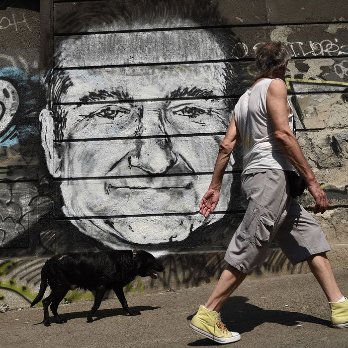 A man with his dog walk past a mural depicting actor Robin Williams in downtown Belgrade on August 13, 2014. Unknown artists drew the Academy Award-winning actor and comedian below a Belgrade bridge to pay a tribute following the news that he had been found dead of an apparent suicide at the age of 63. A man with his dog walk past a mural depicting actor Robin Williams in downtown Belgrade on August 13, 2014. Unknown artists drew the Academy Award-winning actor and comedian below a Belgrade bridge to pay a tribute following the news that he had been found dead of an apparent suicide at the age of 63. AFP PHOTO / ANDREJ ISAKOVIC (Photo credit should read ANDREJ ISAKOVIC/AFP/Getty Images)