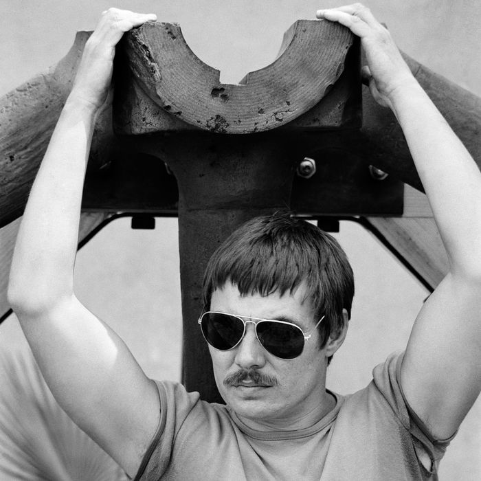 05 May 1979, New York City, New York State, USA --- American artist Chris Burden, working in performance, sculpture, and installation art posing in front of The Big Wheel under construction in 1979.The Wheel is currently on display at The New Museum in New York as part of: