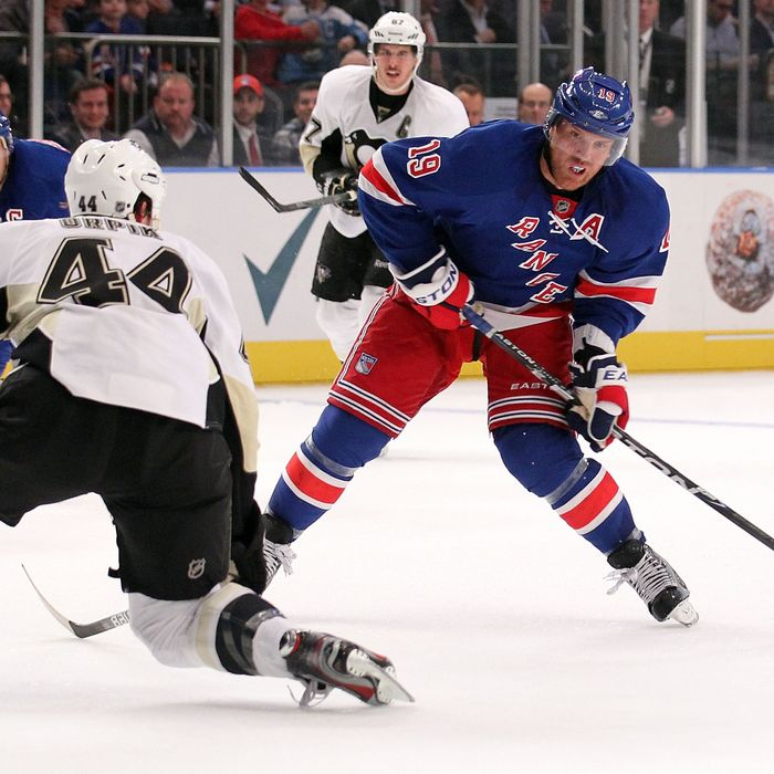 Brad Richards #19 of the New York Rangers shoots to score his goal in the second period against Brooks Orpik #44 of the Pittsburgh Penguin.