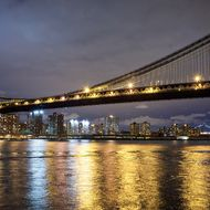 NEW YORK, NY - NOVEMBER 02: The lights of New York's Lower East Side and Chinatown neighborhoods are framed by the Manhattan Bridge on November 2, 2012 in the Brooklyn borough of New York City. Select neighborhoods of Manhattan are beginning to recover power as Con Edison repairs damage done by Superstorm Sandy. (Photo by Andrew Burton/Getty Images)