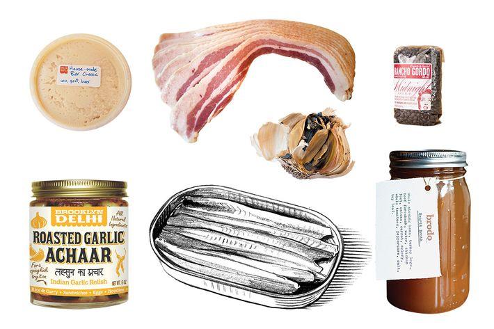 Clockwise, from top left: Milk & Hops' bier cheese, 1732 Garlic Insanity Bacon, Rancho Gordo beans, Brodo broth, black garlic, Don Bocarte anchovies, Brooklyn Delhi's Roasted Garlic Achaar.