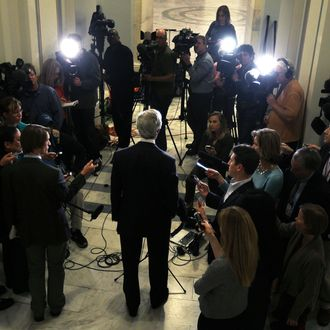 WASHINGTON, DC - NOVEMBER 21: U.S. Sen. John Kerry (D-MA) (C) makes a statement to members of the press on the failure of the