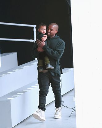 Kanye West with his very own toddler, North West.