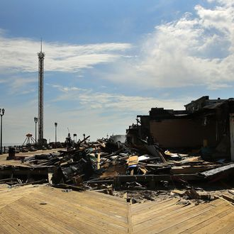 SEASIDE HEIGHTS, NJ - SEPTEMBER 13: The scene of a massive fire that destroyed dozens of businesses is viewed along an iconic Jersey shore boardwalk on September 13, 2013 in Seaside Heights, New Jersey. The 6-alarm fire began in a frozen custard stand on the recently rebuilt boardwalk around 2:30 p.m. and quickly spread in high winds. While there were no injuries reported, many businesses that had only recently re-opened after Hurricane Sandy were destroyed in the blaze. (Photo by Spencer Platt/Getty Images)