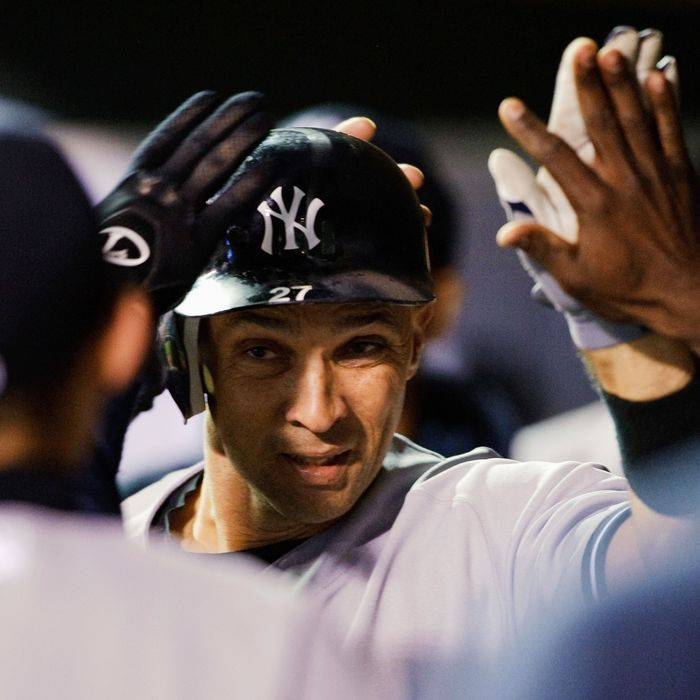 Raul Ibanez #27 of the New York Yankees celebrates hitting a solo home run against the Minnesota Twins during the seventh inning on September 24, 2012 at Target Field in Minneapolis, Minnesota.