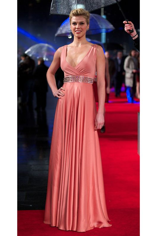US actress Adrianne Palicki poses for pictures on the red carpet as she arrives for the G I Joe: Retaliation, UK Premiere in central London on March 18, 2013.