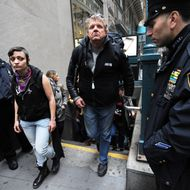 Flanked by New York Police Department officers, demonstrators with 'Occupy Wall Street' exit the subway on their way towards the New York Stock Exchange as they mark the two month anniversary of the protest November 17, 2011 in New York. AFP PHOTO/Stan HONDA (Photo credit should read STAN HONDA/AFP/Getty Images)