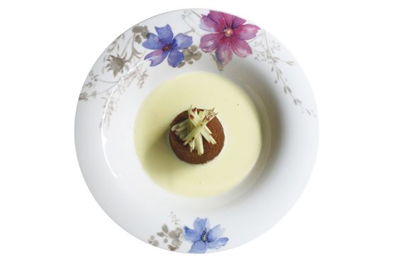 Steamed pudding cake with warm vanilla anglaise and shredded apple.