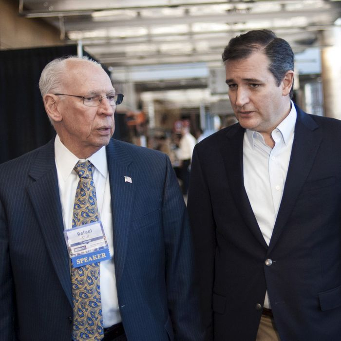 U.S. Republican presidential candidate Cruz speaks with his father at the Freedom 2015 Conference in Des Moines, Iowa