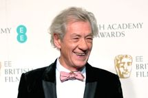 British actor Ian McKellen poses for photographs during the BAFTA British Academy Film Awards at the Royal Opera House in London on February 10, 2013.
