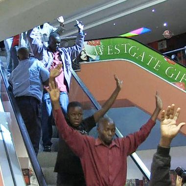 An image grab taken from AFP TV shows civilians being evacuated from a shopping mall following an attack by masked gunmen in Nairobi on September 21, 2013. Masked attackers stormed the packed upmarket shopping mall in Nairobi, spraying gunfire and killing at least 59 people and wounding 175 before holing themselves up in the complex.