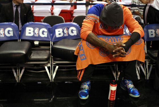 MIAMI, FL - MAY 09:  Forward Amar'e Stoudemire #1 of the New York Knicks sits on the bench against the Miami Heat in Game Five of the Eastern Conference Quarterfinals in the 2012 NBA Playoffs  on May 9, 2012 at the American Airines Arena in Miami, Florida. NOTE TO USER: User expressly acknowledges and agrees that, by downloading and or using this photograph, User is consenting to the terms and conditions of the Getty Images License Agreement.  (Photo by Marc Serota/Getty Images)