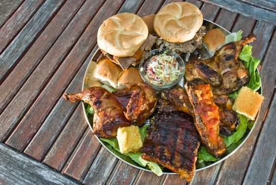 "<a href=""http://bigbadwolfbarbeque.com/"">Big Bad Wolf's House of Barbecue</a><br><i>5713 Harford Rd.; 410-444-6422</i> <br>Richard Gorelick, the restaurant critic for the Baltimore <em>Sun</em>, is the first to admit that the city isn't known for its barbecue: ""Baltimore is not a barbecue town,"" he told us, ""which makes it a great barbecue town."" Instead of having to focus on one particular style, the city can try whatever it wants: ""Folks can concentrate on making good food instead of authentic food, and Scott Smith does more things better at Big Bad Wolf Barbecue."" <br>"